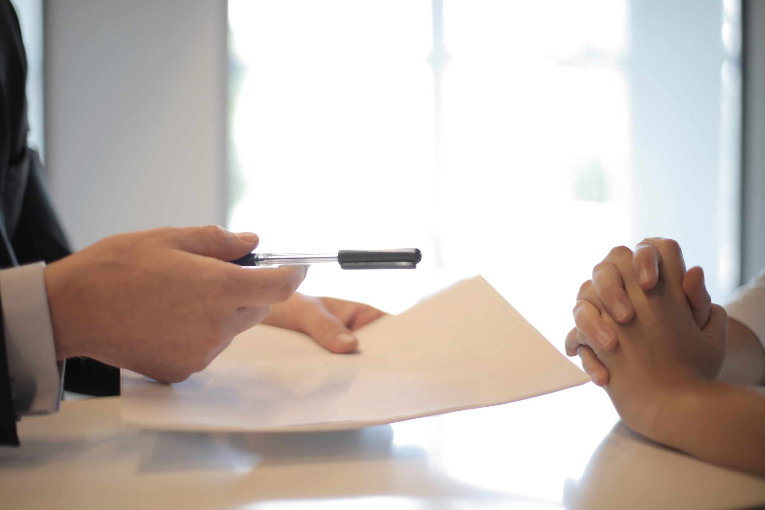 two people the process of signing a document
