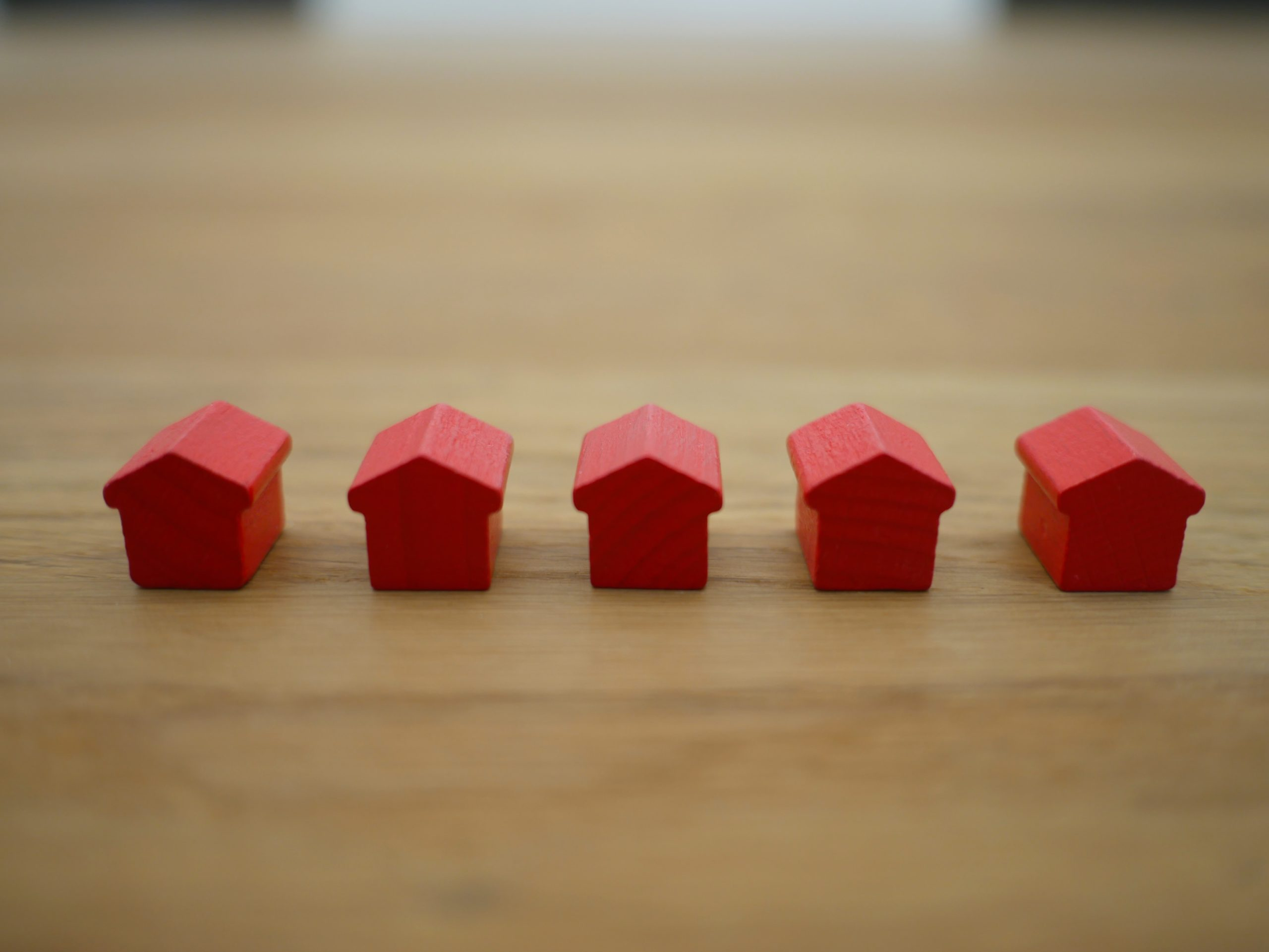 small wooden houses representing purchasing property